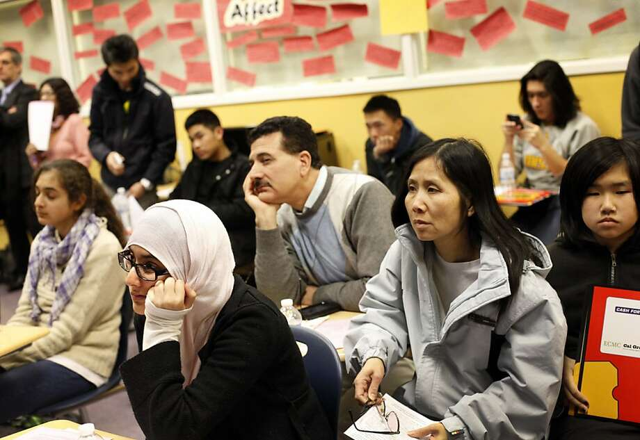 S.F. Mission High School students and their parents attend a meeting to learn about filling out college financial aid forms. Photo: Sarah Rice, Special To The Chronicle