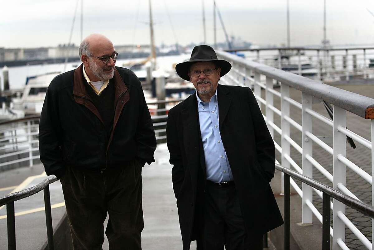 The new executive director of the Bay Conservation and Development Commission Larry Goldzband (left) and new chairman of the commission Zack Wasserman (right) talk about their new focus of responding to higher sea levels at Jack London Sq. in Oakland, Calif., on Wednesday, January 23, 2013.