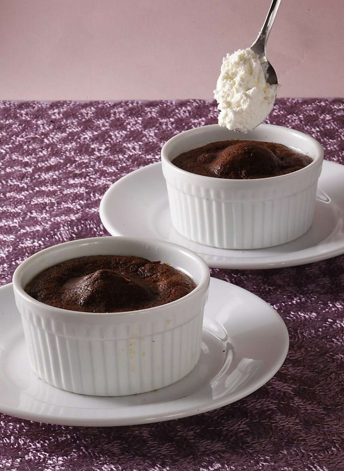 Chocolate souffles for two as seen in San Francisco, California, on Wednesday, January 23, 2013. Food styled by Simon F. F. Young.