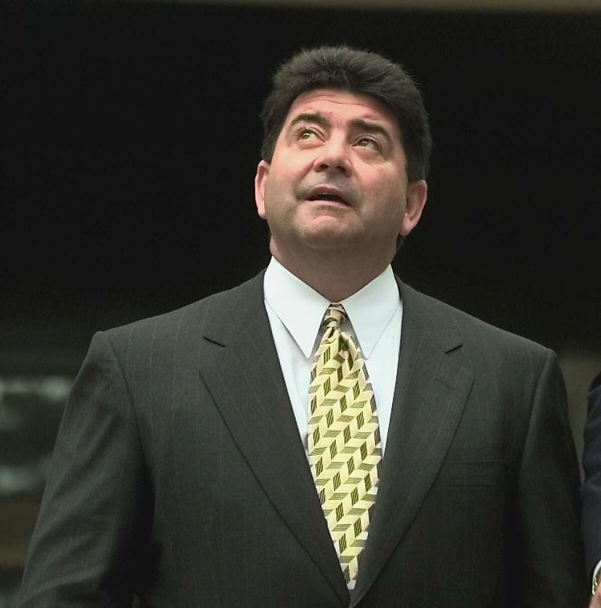 San Francisco 49ers owner Eddie DeBartolo, Jr.looks to the sky as he leaves the Federal Court House in Baton Rouge, La. Tuesday Oct. 6, 1998. DeBartolo pleaded guilty to concealing an alleged extortion and fraud scheme involving former Louisiana Governor Edwin Edwards. DeBartolo, 51, was placed on probation and assessed a total of $1 million in penalties