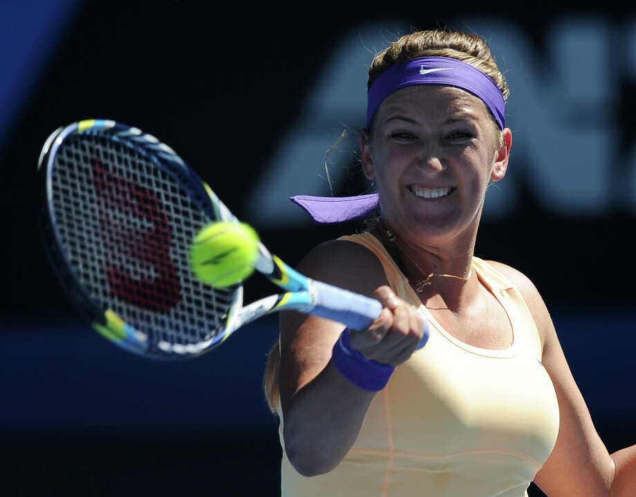 Victoria Azarenka of Belarus hits a forehand return to Sloane Stephens of the US during their semifinal match at the Australian Open tennis championship in Melbourne, Australia, Thursday, Jan. 24, 2013. (AP Photo/Andrew Brownbill) Photo: Andrew Brownbill