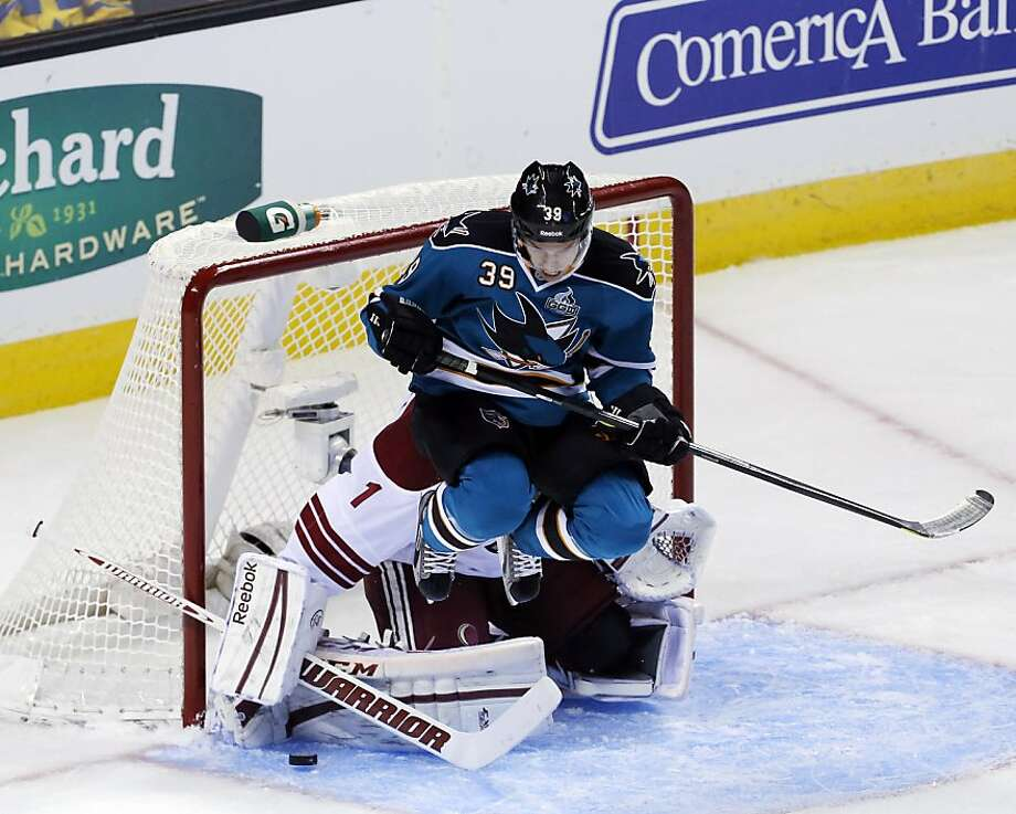 Logan Couture jumps up trying to let the puck go past him and past goalie Jason LaBarbera in the first period. The San Jose Sharks played the Phoenix Coyotes at HP Pavilion in San Jose, Calif., on Thursday, January 24, 2013. Photo: Carlos Avila Gonzalez, The Chronicle