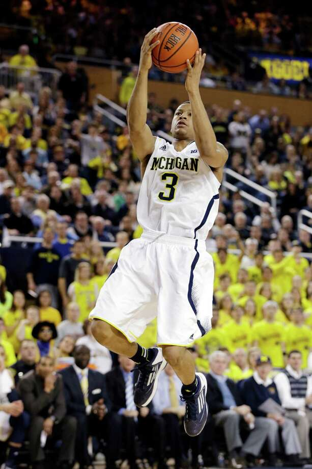 Michigan guard Trey Burke (3) shoots during the second half of an NCAA college basketball game against Purdue in Ann Arbor, Mich., Thursday, Jan. 24, 2013. Burke had 15 points and eight assists as Michigan won 68-53. (AP Photo/Carlos Osorio) Photo: Carlos Osorio
