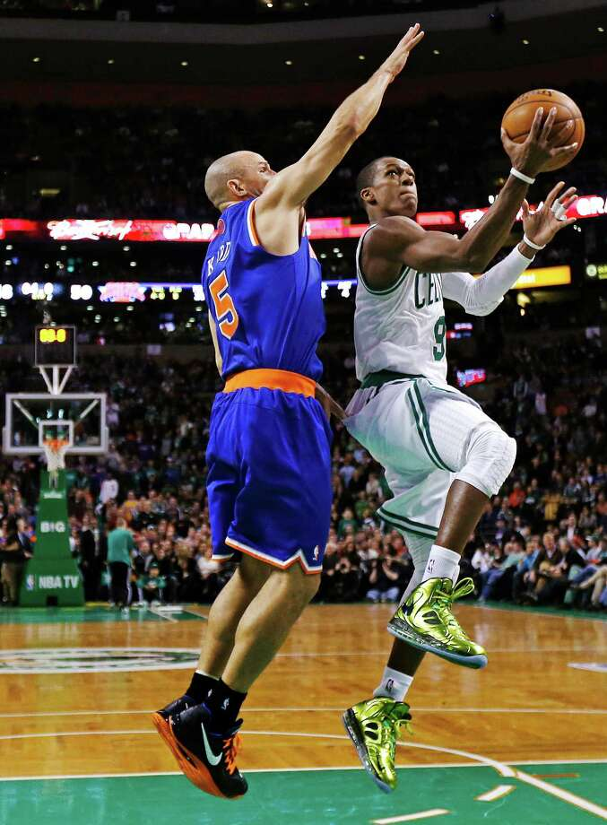 Boston Celtics guard Rajon Rondo, right, drives to the basket against New York Knicks guard Jason Kidd during the second quarter of an NBA basketball game in Boston, Thursday, Jan. 24, 2013. (AP Photo/Charles Krupa) Photo: Charles Krupa
