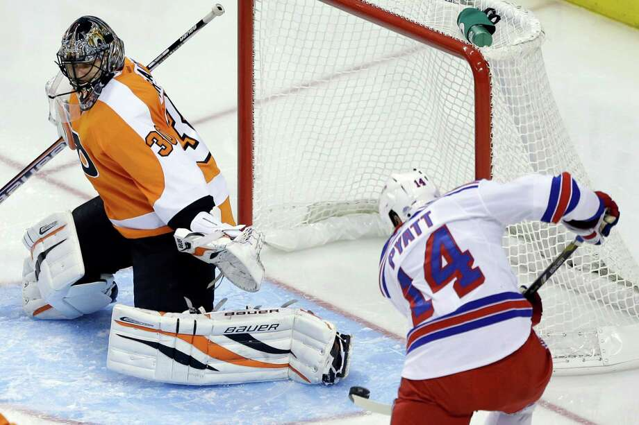 New York Rangers' Taylor Pyatt, right, scores a goal past Philadelphia Flyers' Ilya Bryzgalov, of Russia, during the third period of an NHL hockey game, Thursday, Jan. 24, 2013, in Philadelphia. The Flyers won 2-1. (AP Photo/Matt Slocum) Photo: Matt Slocum