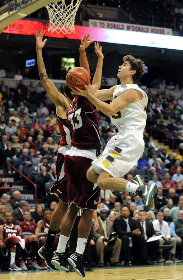 Siena's Rob Poole goes to the basket during their game against the University of Massachusetts at the Times Union Center in Albany, NY Wednesday Nov. 28, 2012. (Michael P. Farrell/Times Union) Photo: Michael P. Farrell / 00020242B