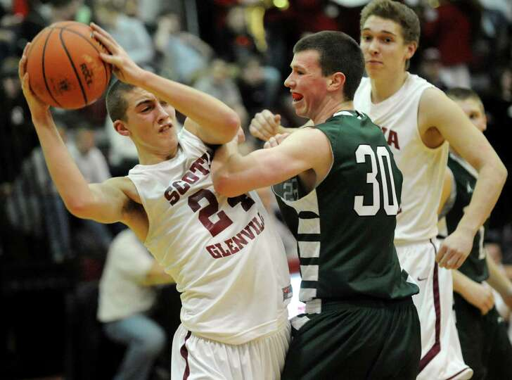 Scotia's Joe Cremo (24), left, looks to pass as Hudson Falls Matt Connolly (30) defends during their