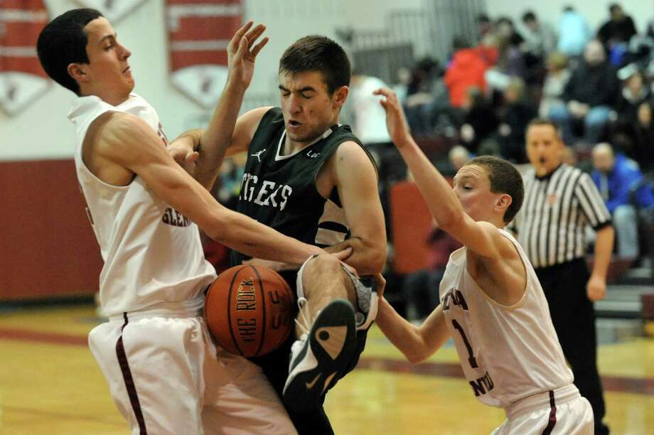 Scotia's Mike Palleschi (44), left, and Scott Stopera (1), left, battle for a rebound with Hudson Falls Cody Mulvey (4) during their basketball game on Thursday, Jan. 25, 2013, at Scotia-Glenville High in Scotia, N.Y. (Cindy Schultz / Times Union) Photo: Cindy Schultz / 00020857A