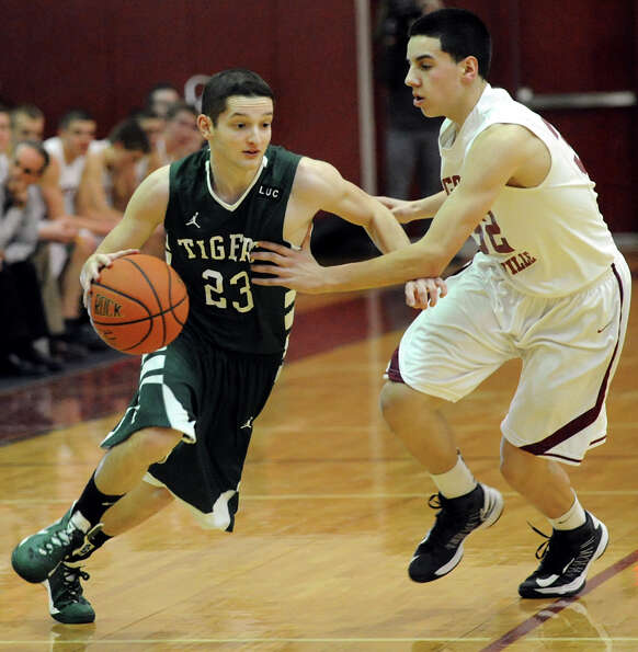 Hudson Falls Wayne Strong (23) drives the ball as Scotia's Dom LeMorta (32) defends during their bas