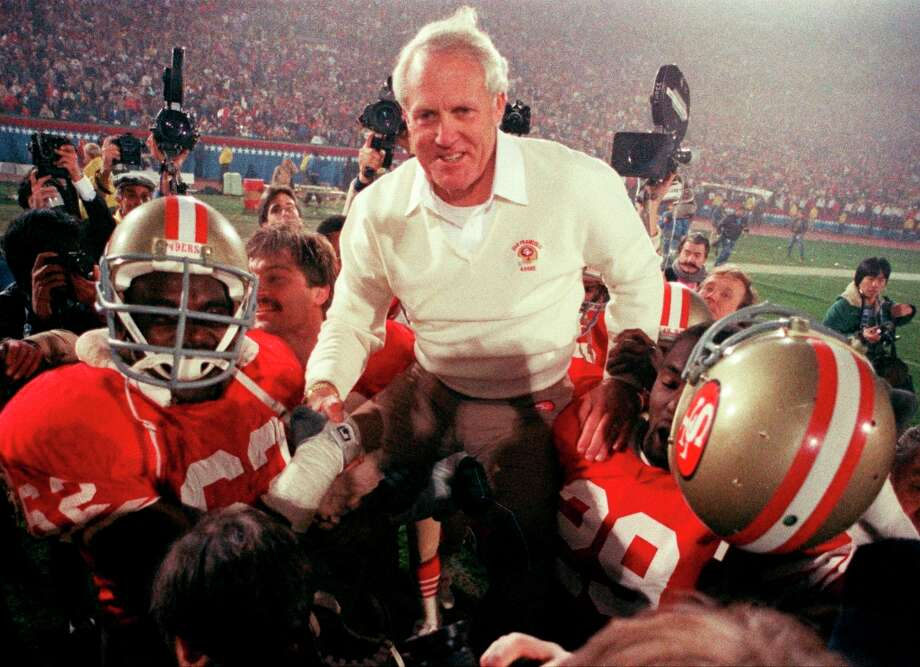 San Francisco 49ers coach Bill Walsh is hoisted on the shoulders of his team after they defeated the Miami Dolphins 38-16 in Super Bowl XIX. Photo: Anonymous, AP / AP