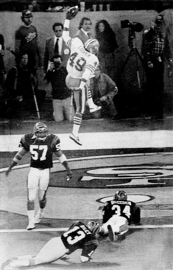 Pontiac Mich Jan 24 1982 — San Francisco 49ers running back Earl Cooper (49) jumps and spikes the ball after a second quarter touchdown pass reception from 49ers quarterback Joe Montana in Super Bowl XVI against the Cincinnati Bengals. Photo: AP / ONLINE_YES