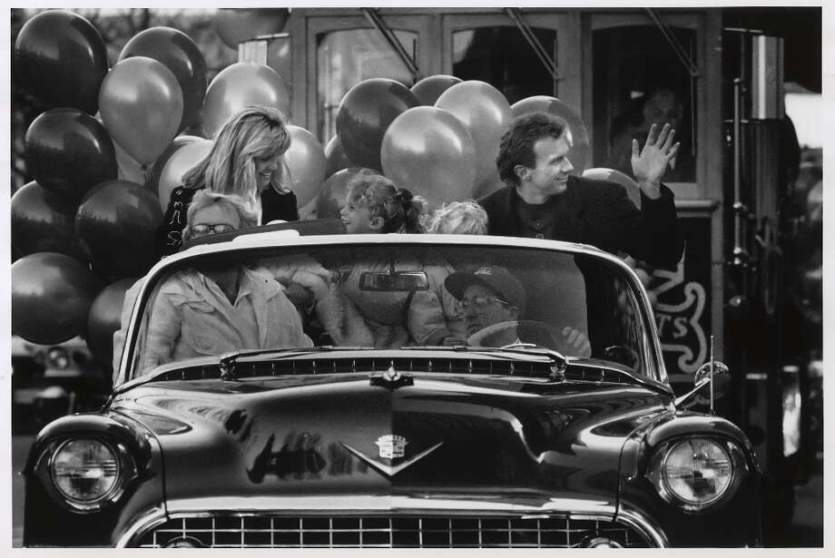 Joe Montana rides down Market Street with his family during the 1990 Super Bowl parade. Photo: Brant Ward, SF Chronicle Staff / SF Chronicle Staff