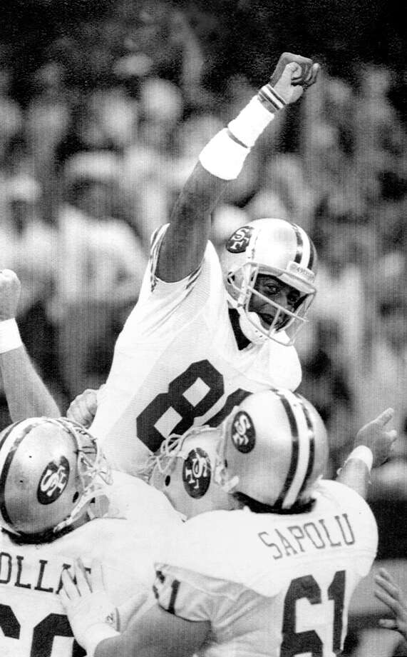 San Francisco 49ers wide receiver Jerry Rice raises his fist in jubilation after scoring his second touchdown of the day with 34 seconds left in the second quarter of Sunday's Super Bowl XXIV. Photo: John Gapps III / ONLINE_YES
