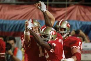 San Francisco 49ers quarterback Joe Montana (16) and wide receiver John Taylor (82) clasp hands after Montana's pass to Taylor at the end of the fourth quarter resulted in a 20-16 victory over the Cincinnati Bengals at Super Bowl XXIII Jan.22, 1989 in Miami.