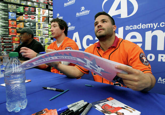 Houston Astros players Jose Altuve and Brett Wallace sign autographs with J.R. Richard and broadcaster Bill Brown at the Academy Sports and Outdoors store at 1604 near Gold Canyon on January 24, 2013. Photo: Tom Reel, Express-News / ©2012 San Antono Express-News