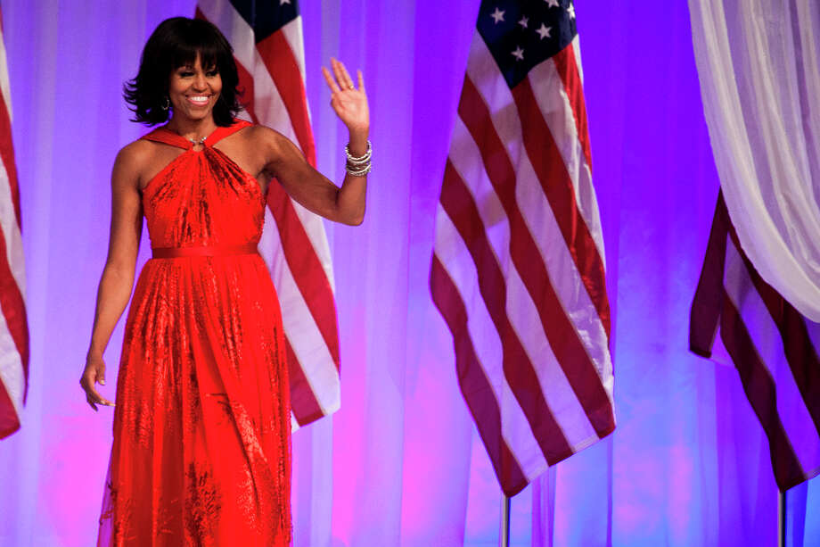 First lady Michelle Obama during the Commander-in-Chief's Inaugural Ball on Inauguration Day, at the Walter E. Washington Convention Center in Washington, Jan. 21, 2013. Obama, who has generally spread her fashion love around to many designers, selected Jason Wu as the designer for both of her inaugural gowns. Photo: LESLYE DAVIS, New York Times / NYTNS