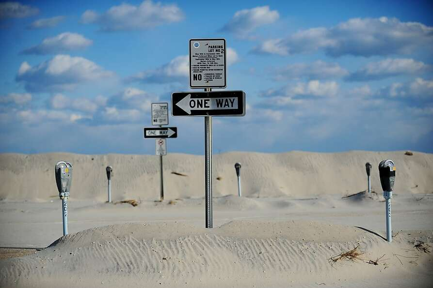 Parking meters stand out from sand dunes Thursday, Jan. 24, 2013, at the Seaside Heights, N.J., amus