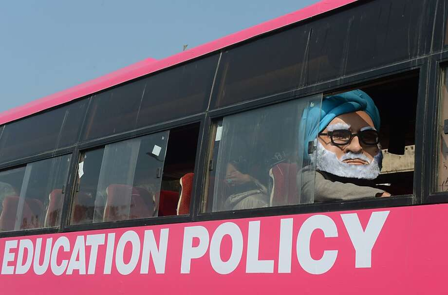 A man dressed as Indian Prime Minister Manmohan Singh sits in the 'Pink Bus' which launched the Campaign for Education as the solution to cure India's rape epidemic at Munirka Bus stand in New Delhi on January 24, 2013.  After one month of lurid reporting on a horrifying gang-rape and murder of a student in a bus by five men in New Delhi, women in the Indian capital say they are not safe in Delhi.  Photo: Raveendran, AFP/Getty Images