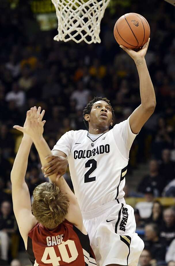 Xavier Johnson (2) shoots over Stanford's John Gage during the Buffaloes' win in Boulder. Photo: Jeremy Papasso, Associated Press