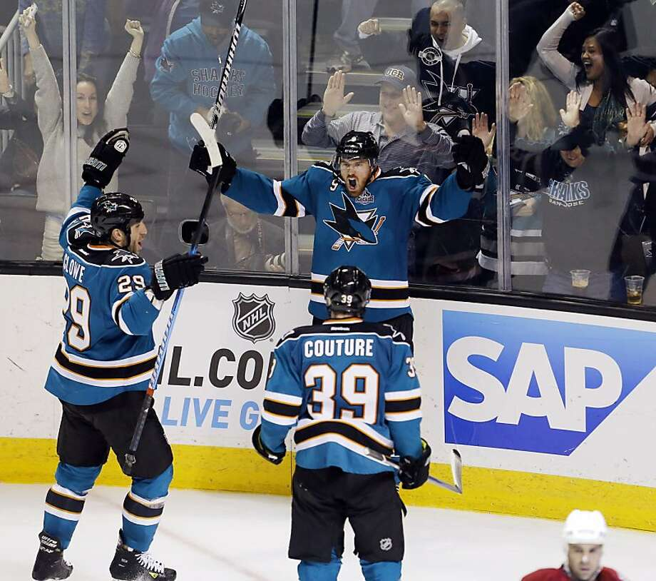 Martin Havlat, center, celebrates his game-tying goal in the third period with Ryane Clowe, left, and Logan Couture, right. The San Jose Sharks played the Phoenix Coyotes at HP Pavilion in San Jose, Calif., on Thursday, January 24, 2013, winning 5-3. Photo: Carlos Avila Gonzalez, The Chronicle