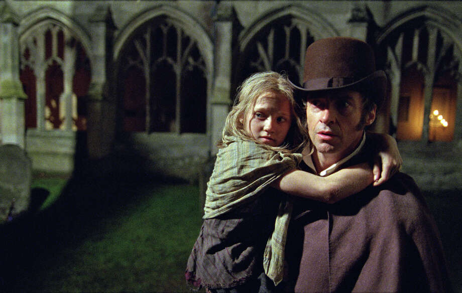 """Les Misérables""Nominations: picture, actor (Hugh Jackman), supporting actress (Anne Hathaway)In theaters: Multiple theaters in Capital RegionOn DVD: UnknownHugh Jackman as Jean Valjean holding Isabelle Allen as Young Cosette in Les Miserables. Photo: Uncredited, AP / Universal Pictures"
