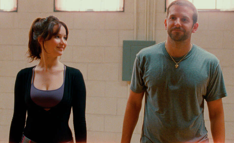 """Silver Linings Playbook""Nominations: picture, actor (Bradley Cooper), actress (Jennifer Lawrence), supporting actor (Robert De Niro), supporting actress (Jacki Weaver), director (David O. Russell)In theaters: Multiple theaters in Capital RegionOn DVD: unknownJoJo Whilden/The Weinstein Company JENNIFER LAWRENCE and BRADLEY COOPER star in SILVER LININGS PLAYBOOK / © 2011 THE WEINSTEIN COMPANY"