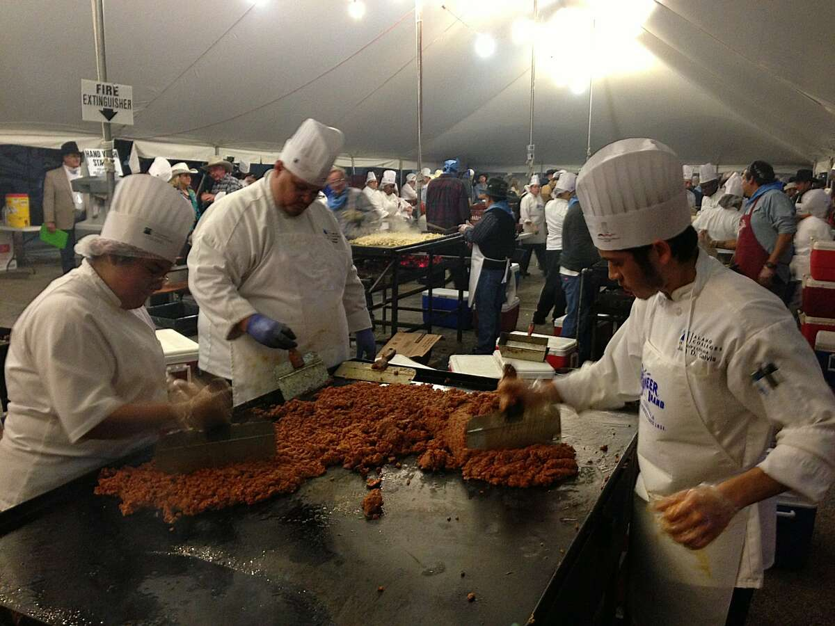 Workers prepare the fixings for tacos during the 35th annual Cowboy Breakfast at Cowboys Dance Hall on Friday, Jan. 25, 2013. The outdoor breakfast for thousands traditionally kicks off the San Antonio Stock Show and Rodeo.