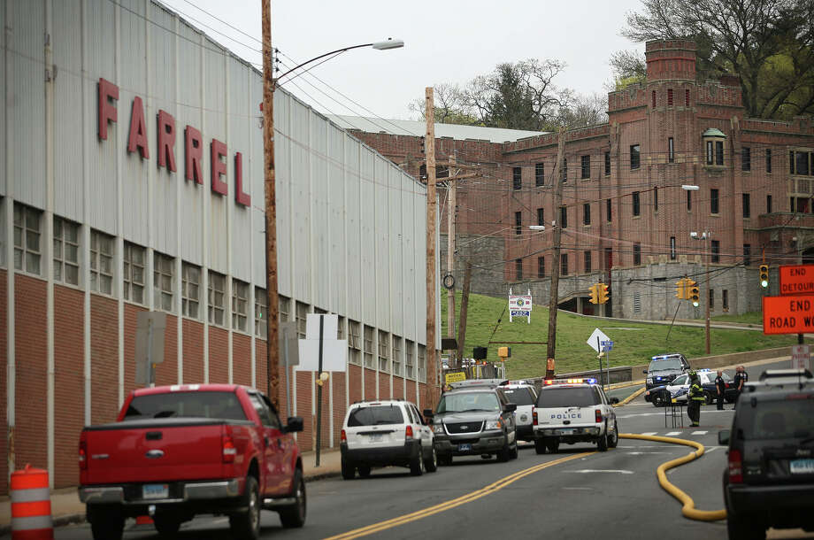 Valley firefighters and policein front of the Farrel Corporation factory on Main Street in downtown Ansonia, the scene of a fire on Wednesday, April 27, 2011. Photo: Brian A. Pounds, ST / Connecticut Post