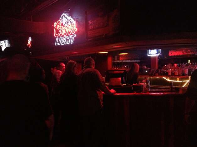 Inside the Cowboys Dance Hall, people lined up as early as 6 a.m. for beer and liquor. Photo: Sarah Tressler/Express-News