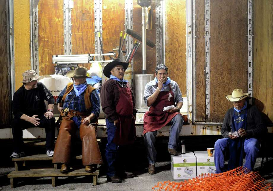 Kenneth Burkman, left, D.C., Pascual Valadez, Felipe Lopez and Jesse Martinez take a break from preparing tacos during the 35th annual Cowboy Breakfast at Cowboys Dance Hall on Friday, Jan. 25, 2013. Several thousand people turned out for the event, which traditionally kicks off the San Antonio Stock Show & Rodeo, for free tacos, biscuits, coffee and tamales. Photo: Billy Calzada, San Antonio Express-News / SAN ANTONIO EXPRESS-NEWS