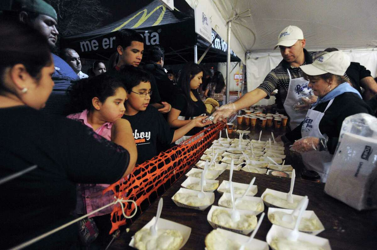 People pick up biscuits and gravy during the 35th annual Cowboy Breakfast at Cowboys Dance Hall on Friday, Jan. 25, 2013.