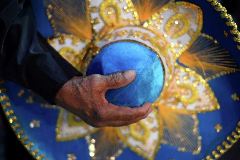 David Mata holds a charro hat during the 35th annual Cowboy Breakfast at Cowboys Dance Hall on Friday, Jan. 25, 2013. Several thousand people turned out for the event, which traditionally kicks off the San Antonio Stock Show & Rodeo, for free tacos, biscuits, coffee and tamales. Photo: Billy Calzada, San Antonio Express-News / SAN ANTONIO EXPRESS-NEWS
