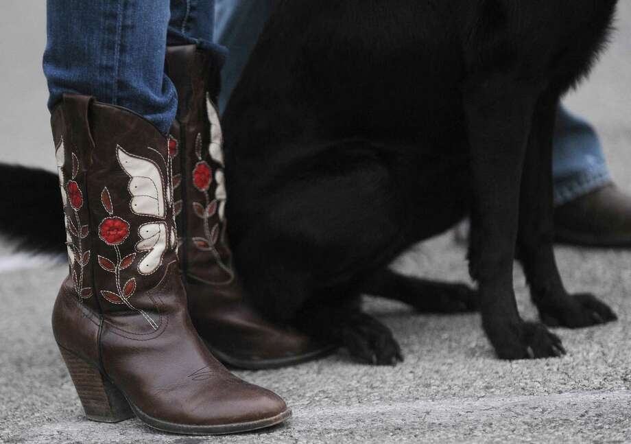 A dog and its owner in ornate boots attend the 35th annual Cowboy Breakfast at Cowboys Dance Hall on Friday, Jan. 25, 2013. Photo: Billy Calzada, San Antonio Express-News / SAN ANTONIO EXPRESS-NEWS