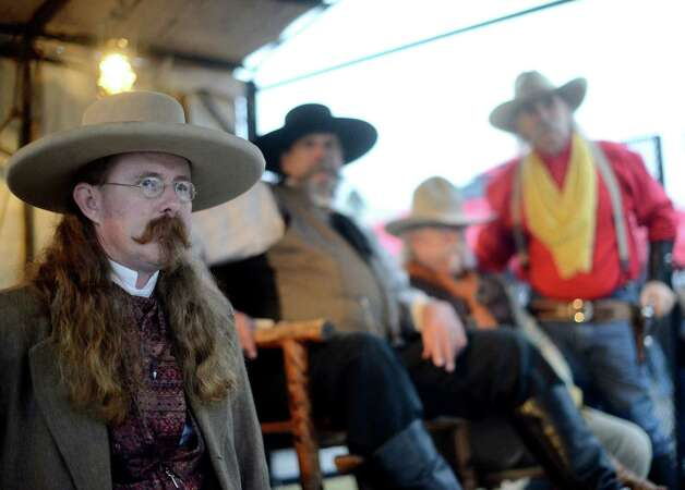 Jason Brown, left, a member of the Texas Wild Bunch, watches with other members during the 35th annual Cowboy Breakfast at Cowboys Dance Hall on Friday, Jan. 25, 2013. Several thousand people turned out for the event, which traditionally kicks off the San Antonio Stock Show & Rodeo, for free tacos, biscuits, coffee and tamales. Photo: Billy Calzada, San Antonio Express-News / SAN ANTONIO EXPRESS-NEWS