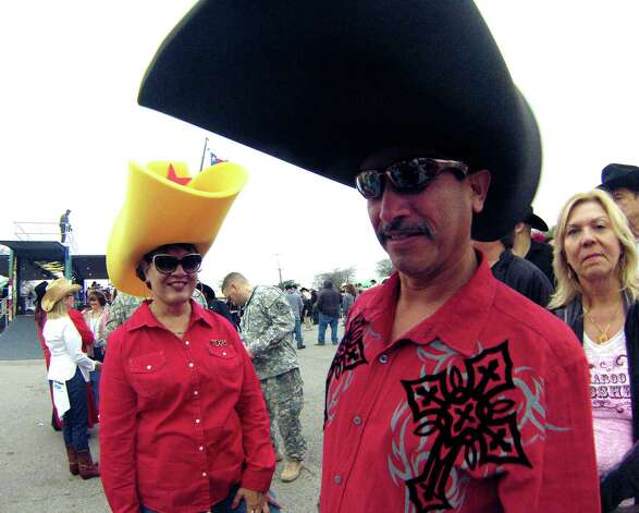 Albert Limon and Pauline Grossman wear big foam hats to the 35th annual Cowboy Breakfast at Cowboys Dance Hall on Friday, Jan. 25, 2013. Photo: Billy Calzada, San Antonio Express-News / SAN ANTONIO EXPRESS-NEWS