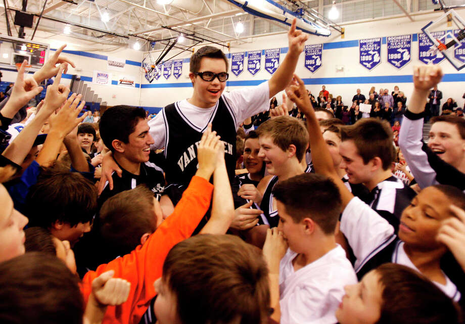 Van Hoosen's Owen Groesser is hoisted on the shoulders of teammates as they celebrate after a middle school basketball game on Thursday at Rochester High School in Rochester, Mich. Groesser, an eight-grader with Down Syndrome, made ESPN'S SportsCenter Top 10 Plays after hitting two 3-pointers in the first game he got to play this season on Wednesday. Photo: Andre J. Jackson, Associated Press / Detroit Free Press