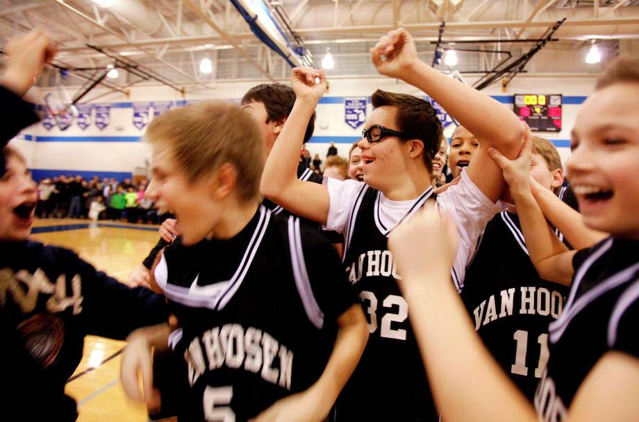 Van Hoosen's Owen Groesser celebrates with teammates. Photo: Andre J. Jackson, Associated Press / Detroit Free Press