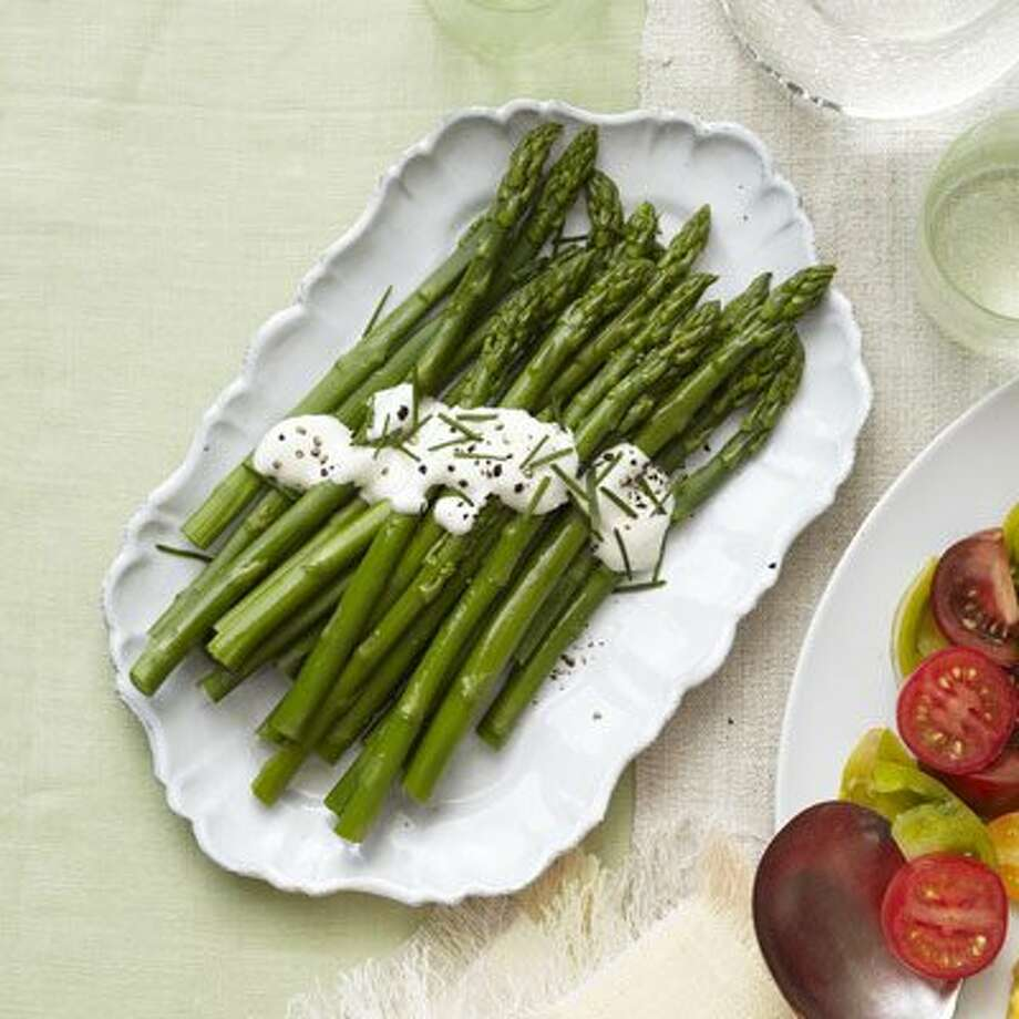 DELISH0620: Good Housekeeping recipe for Asparagus with Lemon Cream. Photo: Kate Mathis