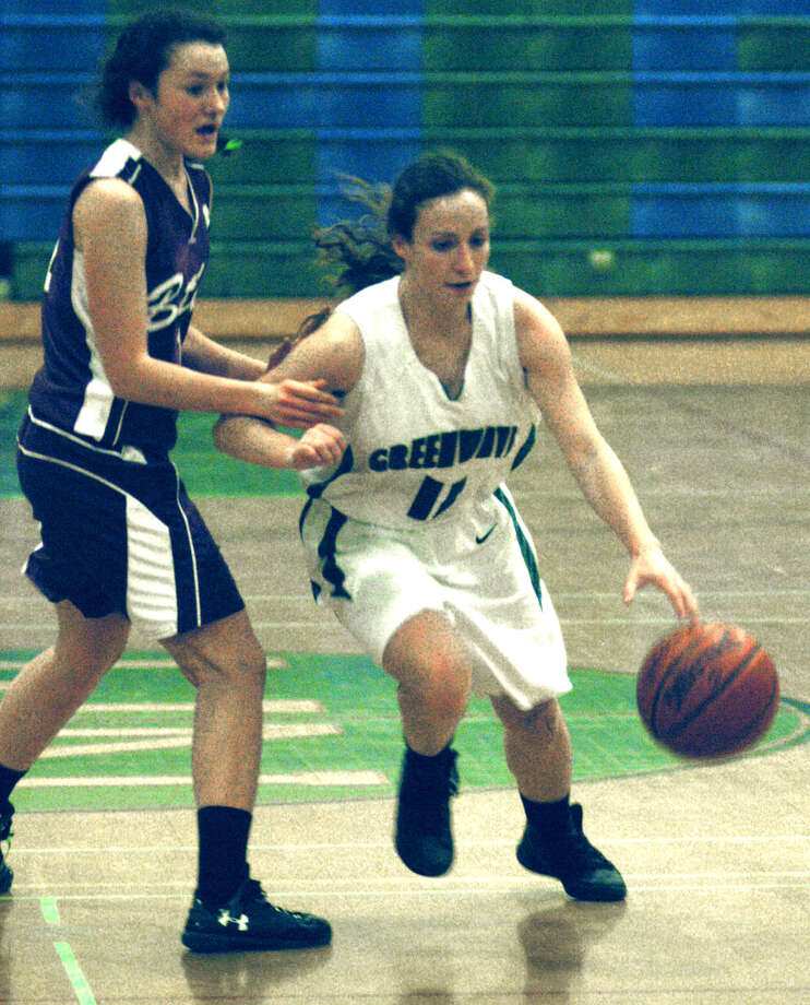 Julianna Fusco of the Green Wave makes her move to the hoop in spite of the handcheck of a Wildcat defender during New Milford High School girls' basketball's game vs. Bethel, Jan. 8, 2013 Photo: Norm Cummings