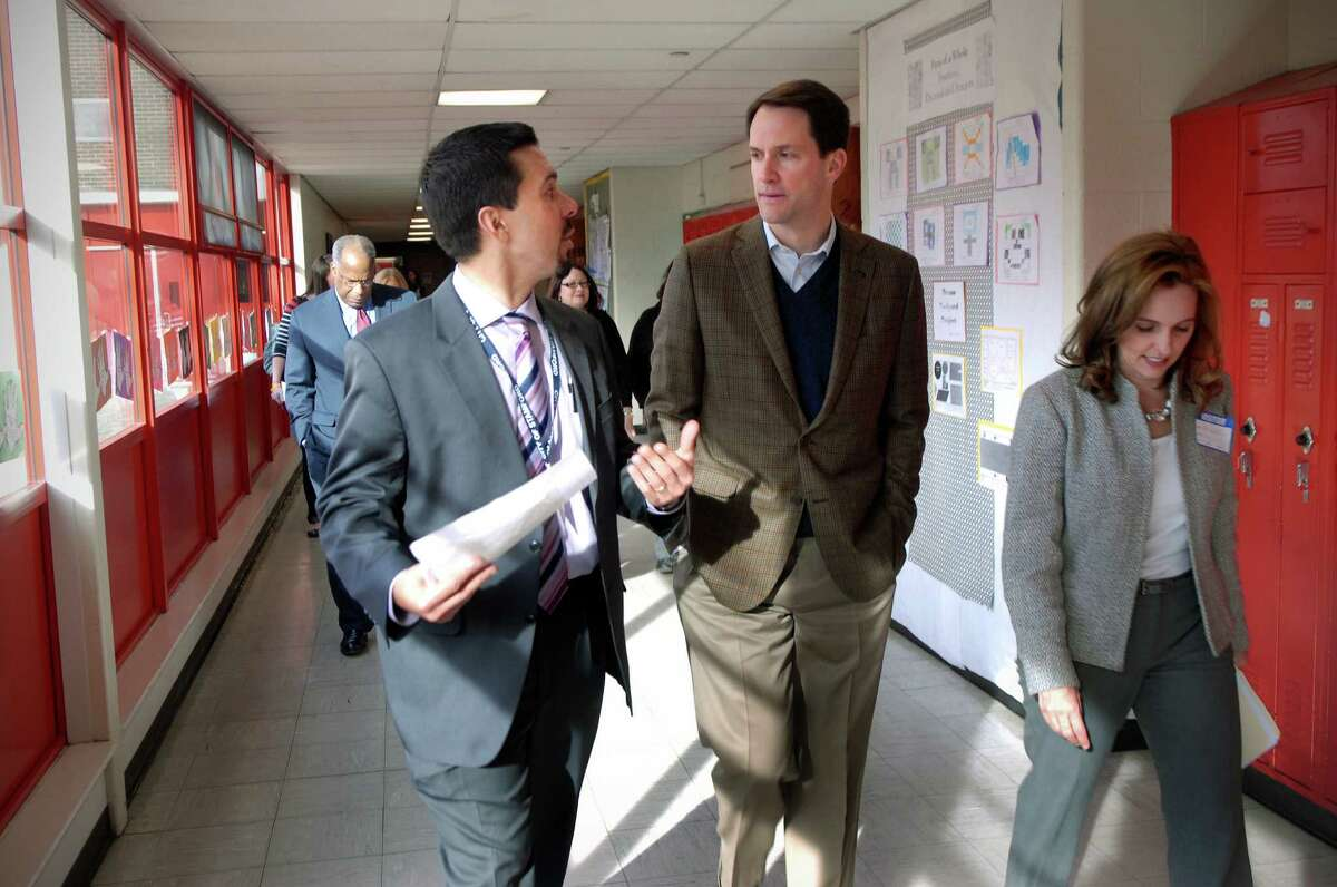 Congressman Jim Himes visits Turn of River Middle School in Stamford, Conn. on Friday January 25, 2013 touring the school with TOR principal Mike Fernandes (left) and GE Foundation director for US education Kelli Wells.
