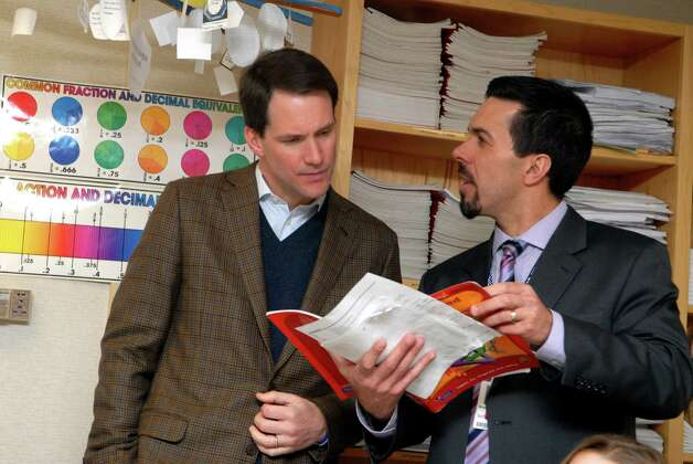 Congressman Jim Himes visits Turn of River Middle School in Stamford, Conn. on Friday January 25, 2013 with TOR principal Mike Fernandes. Photo: Dru Nadler / Stamford Advocate Freelance