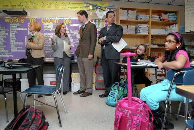 Congressman Jim Himes visits Turn of River Middle School in Stamford, Conn. on Friday January 25, 2013 with Winnie Hamilton, Superintendent of Stamford Public Schools, GE Foundation director for US education Kelli Wells and TOR principal Mike Fernandes. Photo: Dru Nadler / Stamford Advocate Freelance