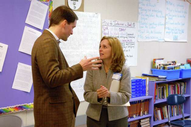 Congressman Jim Himes visits Turn of River Middle School in Stamford, Conn. on Friday January 25, 2013 speaking with GE Foundation director for US education Kelli Wells. Photo: Dru Nadler / Stamford Advocate Freelance