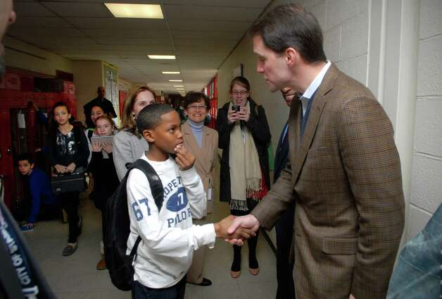 Sixth grader Nyshawn Blake shakes hands with Congressman Jim Himes during his visit to Turn of River Middle School in Stamford, Conn. on Friday January 25, 2013. Photo: Dru Nadler / Stamford Advocate Freelance