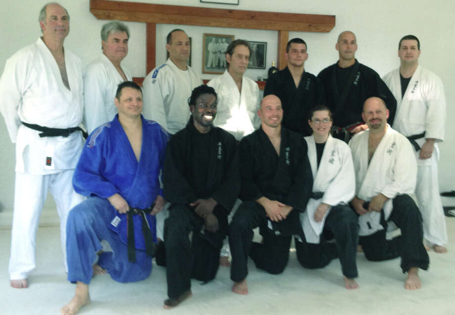 The Yudansha (black belts) of Zen Do Jujitsu gather together for a photo. On hand are, from left to right, front row, Jim Callaghan, 1st degree; Patrick Mitchell, 2nd degree; Cortland Hembrecht, 2nd degree; Jennifer Sperry, 2nd degree; and Michael Gordon, 1st degree; back row, Sensei John Mahoney; Sensei Dan Robb; Sensei Lajoie; Sensei Walter Miller, 6th degree; Sean Doenias, 1st degree; Sensei Sean Jugler, 6th degree; and Sensei JJ Sperry, 3rd degree September 2012 Photo: Contributed Photo