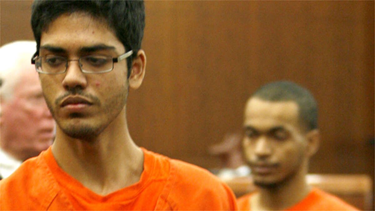 Danish Moazzam Minhas, 17, (foreground) and Nur J. Mohamed, 18, (background) appear in the 263rd State District Court at the Harris County Criminal Courthouse, Thursday, Jan. 7, 2010.