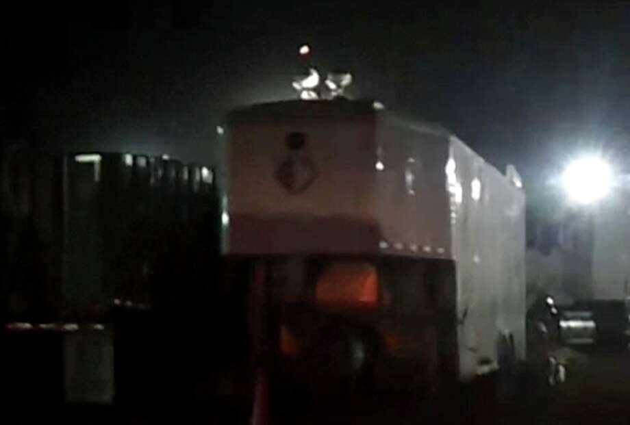 Lights hover above a La Salle County oil field drilling site in La Salle in this video screen shot. The unidentified lights and oject were captured on video by an oilfield worker at the site and aldo witnessed by 20 others.