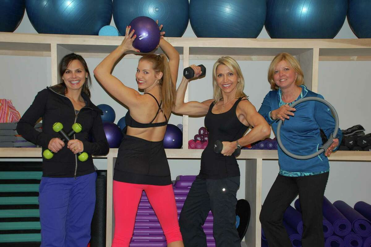 Jarret Liotta/For the Darien News The staff of the Flair Fitness Studio, in its new location in the Goodwives Shopping Center, includes, from left, Dina Fay, Amber Allen, Martha Guttuso and co-owner Amy Shelton.