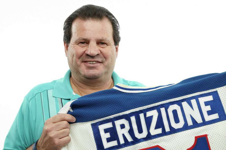 "This Dec. 12, 2012 handout photo, provided by Heritage Auctions, shows former United States Olympic hockey player Michael Eruzione in Dallas with a jersey from his team's sensational win against the Soviet Union hockey team at the 1980 Winter Olympics. The ""Miracle On Ice"" paraphernalia will be offered by Dallas-based Heritage Auctions in New York on Feb. 22, the 33rd anniversary of that historic game. (AP Photo/Courtesy of Heritage Auctions)"
