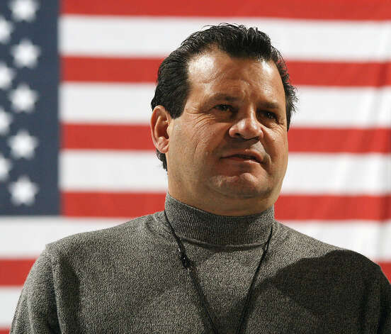 "Mike Eruzione, captain of the1980 U.S. Olympic hockey team, stands on the ice at the Olympic Center, the same ice rink where he scored the winning goal against the Soviet Union Olympic hockey team, while attending a reception Thursday, Feb. 5, 2004,  in Lake Placid, N.Y., prior to a screening of the film ""Miracle."" Photo: TODD BISSONETTE, AP / AP"